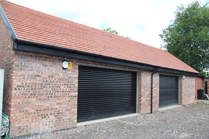 Double garages with upstairs utilise lofts build for Garage with upstairs